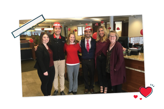 Choice Bank employees celebrating Giving Hearts Day by wearing red.