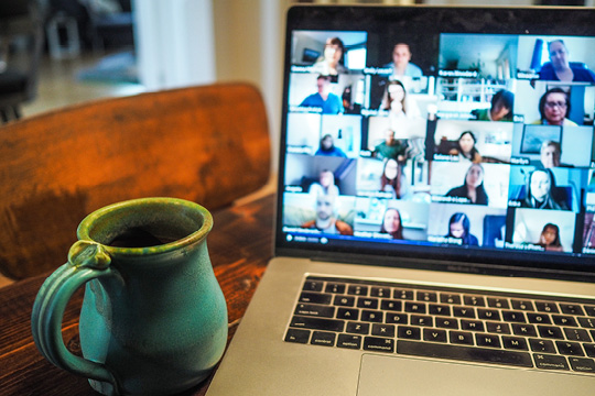 Zoom meeting with a cup of coffee.