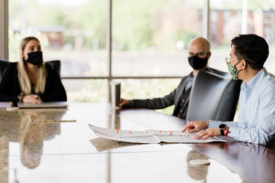 people in masks meeting